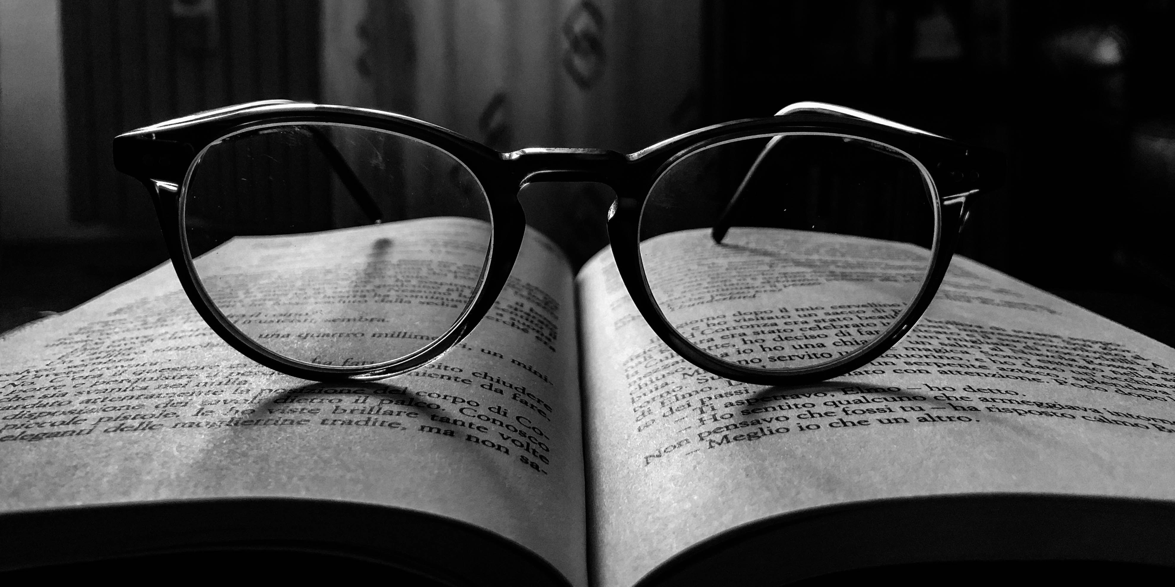 black frame eyeglasses on book