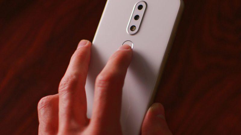 man holding white smartphone